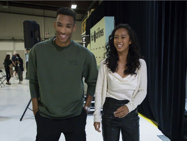 Leylah Fernandez makes a joke about 'having to make herself taller' as she walks beside Félix Auger-Aliassime at a press conference in the Dorval area of Montreal Tuesday, September 14, 2021, a few days after their participation in the U.S. Open. Auger-Aliassime made it to the semi-final match and Fernandez made it to the final match.