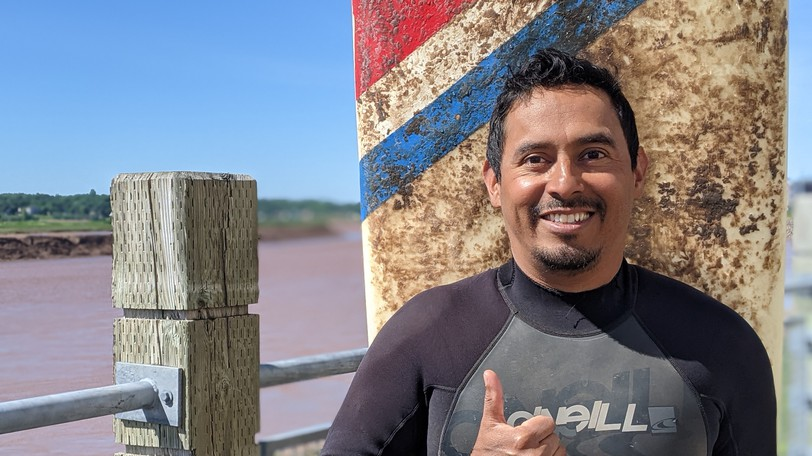 """Melvin Perez, who has been surfing Moncton's Tidal Bore fo nine years, has written a song about his love for the Petitcodiac River called """"The Bridge."""""""