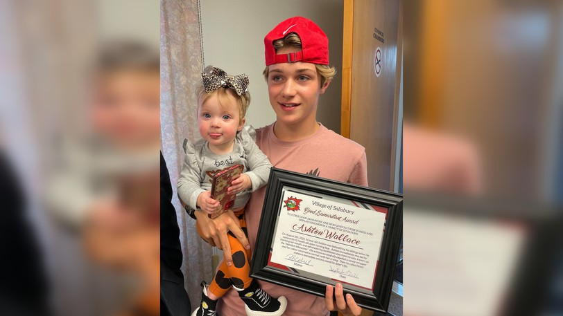 Ashton Wallace holds his baby sister Brooklyn prior to the regular meeting of municipal council in Salisbury Monday night. The 14-year-old was presented with a Good Samaritan award for saving his sister's life on Aug. 5.