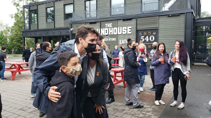 Liberal Leader Justin Trudeau poses for pictures during a stop in Fredericton Wednesday, alongside candidate Jenica Atwin. The two were at The Picaroons Roadhouse talking to voters.