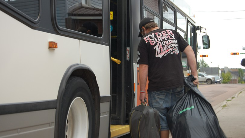 People infected with COVID-19 were shuttled on city buses from the Harvest House emergency shelter in downtown Moncton to an undisclosed location for self-isolation on Wednesday, Sept. 15, 2021.