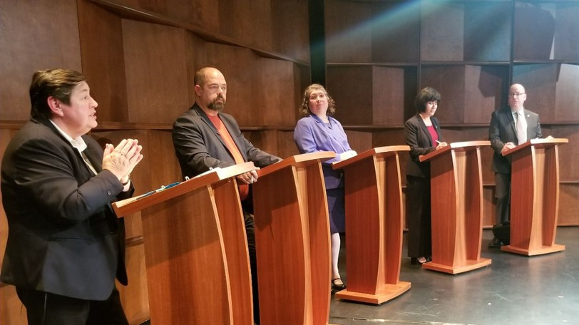 Federal candidates for Moncton-Riverview-Dieppe, from left, include Darlene Smith of the Conservative Party, Serge Landry of the NDP, Lorilee Carrier of the PPC, incumbent Ginette Petitpas Taylor of the Liberal Party and Richard Dunn of the Green Party, pictured at a debate Wednesday night at the Dieppe Arts and Culture Centre.