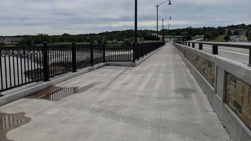 The new bridge over the Petitcodiac River will be opened to traffic Friday at 2 p.m. The bridge has a concrete deck with four lanes for vehicle traffic and a pedestrian/bicycle lane on the side. The bridge has decorative lighting, black iron railings and rest stops along the pedestrian lane which offer a view of the river.