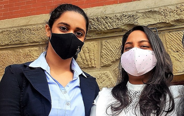 Divleen Kar, left, from India, and Swarna Noojee from the Island of Mauritius, students at UNB, both received COVID-19 vaccines while in New Brunswick.