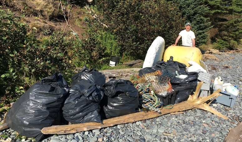 Carl Duivenvoorden poses with the results of his Terry Fox Run beach cleanup at Liberty Beach on Campobello Island in 2020. Duivenvoorden plans to do another beach cleanup this year.
