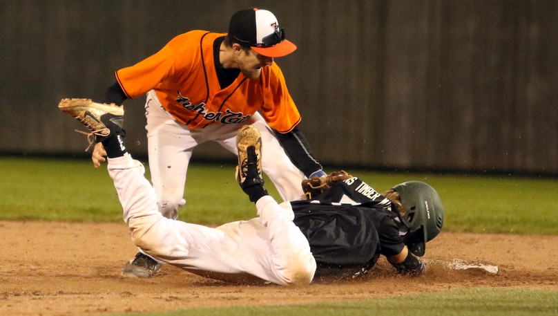Moncton Fisher Cats' Stefan Martin tags out Charlottetown Islanders' Taylor Larkin as he tries to slide back to second base during Game 3 of the New Brunswick Senior Baseball League final on Thursday at Kiwanis Park.