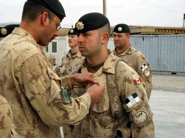 """""""It is still upsetting to think about, because you did have a connection there,"""" Canadian veteran Matt Anderson (shown receiving pin) says of the collapse of Afghanistan's government to the Taliban."""