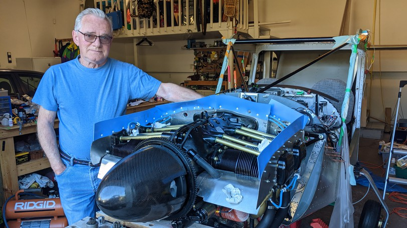John Navaux stands next to his Zenith 750 Cruzer in his garage at his home in Moncton. Navaux has nearly finished building his plane and plans to take to the skies in October.
