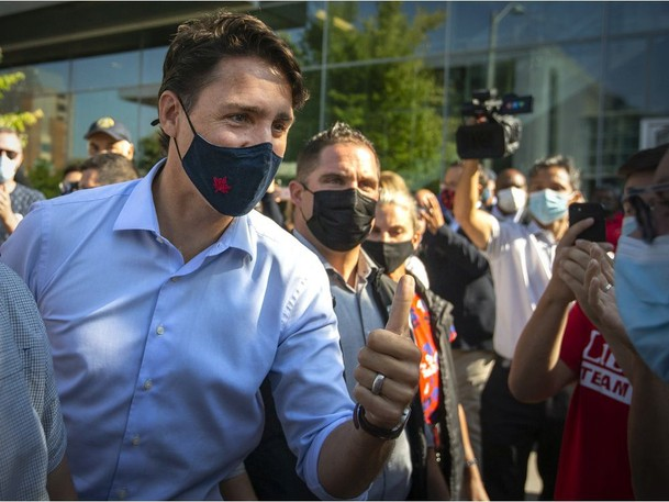 Liberal Leader Justin Trudeau meets with supporters as he departs from a campaign stop at the Ed Lumley Centre for Engineering Innovation on Friday, September 17, 2021.