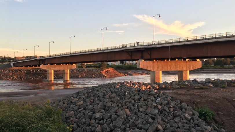 The new bridge over the Petitcodiac River has unpaved service roads underneath it on both sides. This photo is looking southwest from the Moncton side toward Riverview.