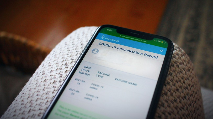 Public Health launched anew way to access proof of COVID-19 vaccination online, after reports of delays to get a registration number under the old system.The MyHealthNB vaccination status webpage is seen on a mobile phone.