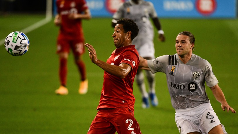 Toronto FC's Justin Morrow and Samuel Piette of CF Montreal compete for the ball in a Major League Soccer match in Sept. 1, 2020 at BMO Field.