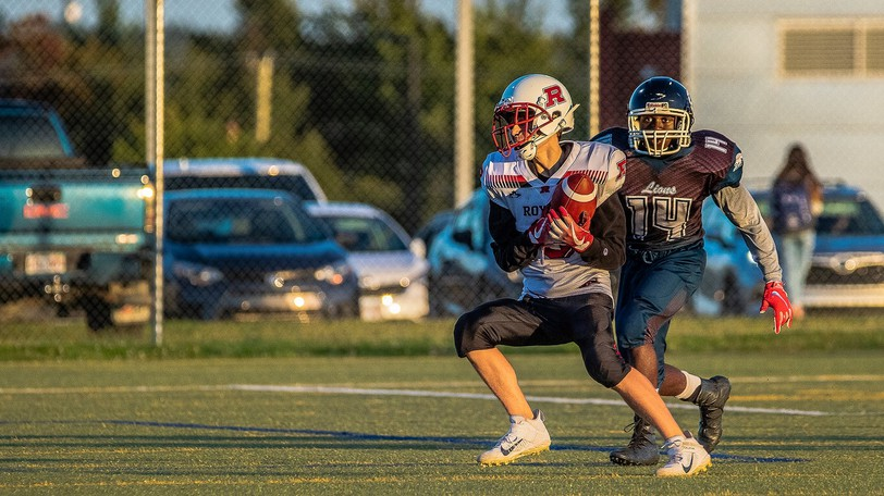 Rotimi Aralusi (14) of the Leo Hayes St. Mary's Lions pursues Riverview High Royals receiver Ethan Hansen in New Brunswick High School Football League 12-man AAA division play Friday at Scotiabank Park North. The Royals won 28-2.