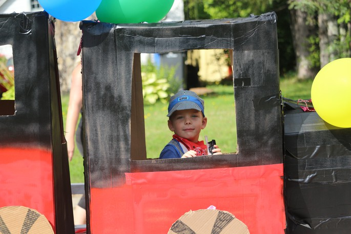 Joshua Manuel smiles for the camera as his float travels along Main Street during the Canterbury Days parade on Sept. 18.