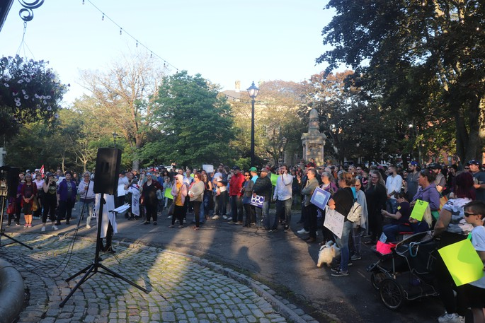 A rally opposing vaccination passports was held at King's Square on Saturday. More than 100 people attended.