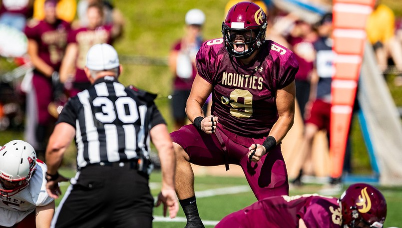 Mount Allison Mounties defensive lineman Reece Martin of Moncton, right, celebrates a play during an AUS football game against the Acadia Axemen on Saturday at Alumni Field in Sackville.