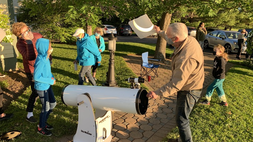 Astronomy enthusiast David Hunter views a partial solar eclipse at a viewing party in Florenceville-Bristol this summer. Hunter hopes UNB engineering students will help the town design a camera-aiming system for a 2024 total solar eclipse viewing.