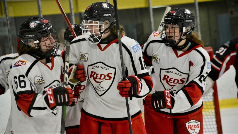 From left, EDZA West TNT Reds' Ella Lawrence (66) celebrates her goal with Sahara McKay (16) and Lauren Waters (24) in a 2-2 tie with the EDZA East Moncton Rockets.