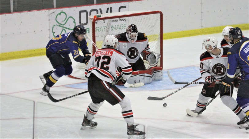 UNB goaltender Rylan Parenteau made 28 saves to backstop the Reds to a 3-0 road win over the Universite de Moncton Aigles Blues on Sunday.