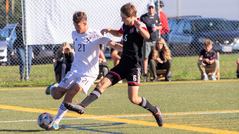 UNB Reds midfielder Lars Gierull challenges St. FX defender Lewis Dye for possession of the ball during AUS men's soccer conference action Sunday at Scotiabank Park North. St. FX won 1-0.