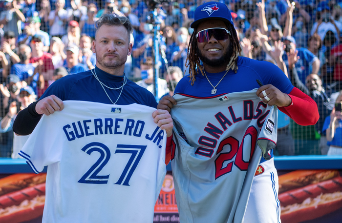 Former Blue Jays star Josh Donaldson (left) and current MVP candidate Vladimir Guerrero Jr. exchange jerseys after Toronto defeated the Twins on Sunday, Sept. 19, 2021.