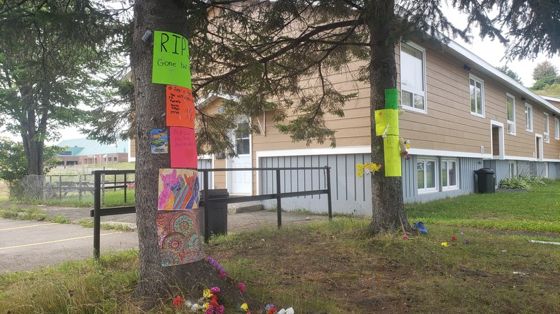 A makeshift memorial near the apartment on Tingley Crescent in Campbellton where the body of Serge Chamberlain, 38, was found on July 27. Ronald Patrick Savoy, charged with second-degree murder in the death, was in court on Sept. 20 where the court was told doctors undertaking a psychiatric examination of Savoy wanted another two weeks to do this.