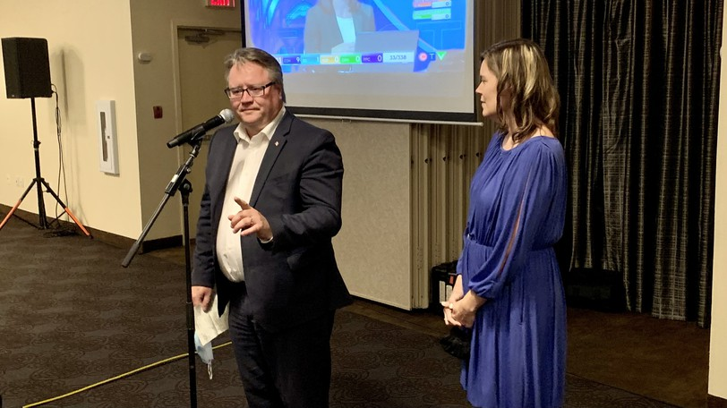 Conservative incumbent Richard Bragdon gives a victory speech to family and supporters in the Best Western Plus hotel in Woodstock as wife Crystal looks on.