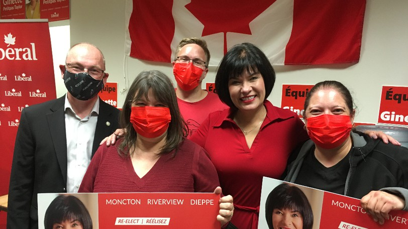 Ginette Petitpas Taylor is shown with supporters at her office on St. George Street on Tuesday, Sept. 20, 2021.