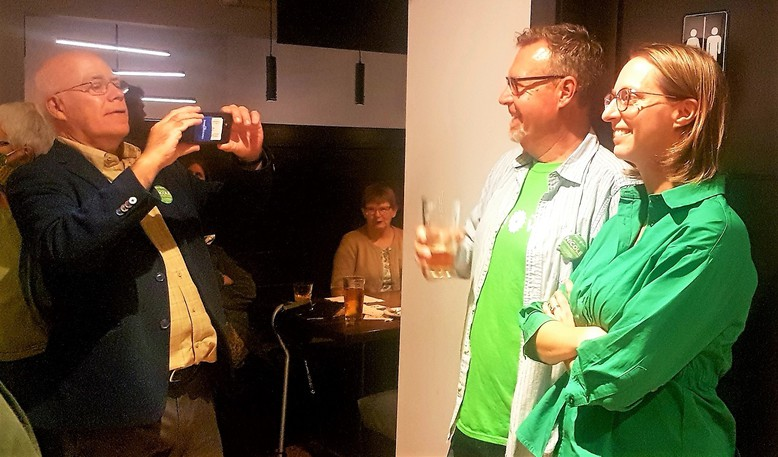 Provincial Green Leader David Coon photographs federal Fredericton Green candidate Nicole O'Byrne while waiting on election results Monday night. The Greens came in a distant third in Fredericton, part of a wider provincial collapse in the party's support.