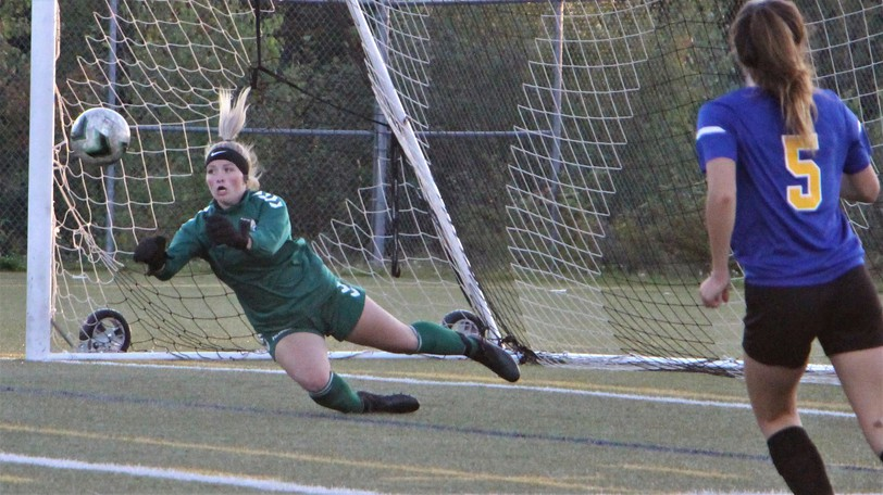 Leo Hayes keeper Wynn Campbell punches a ball away from the Lions net during Monday's 1-0 win over ESA.