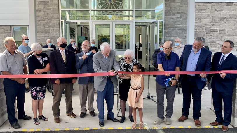 The ribbon is cut to celebrate the new Woodstock Baptist Church. From left are Brent Hatchard, Hatchard Engineering;Marg Arnold, chair of the Future is Now committee;Woodstock MayorArt Slipp;Gordon Sparrow, chair of the board of trustees; 101-year-old church member Fred Thomas with wifeDoreen Thomas;Bella Vistan;Perry Eldridge; chair of theBaptist Foundation;Greg Jones, Canadian Baptists of Atlantic Canada,Craig Woodcock, senior pastor of Woodstock Baptist Church