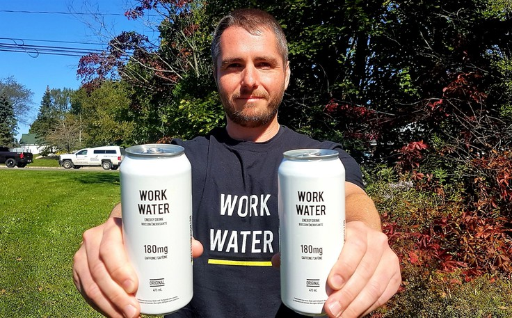 Fredericton businessman Brody Hanson holds cans of his new energy drink, Work Water.