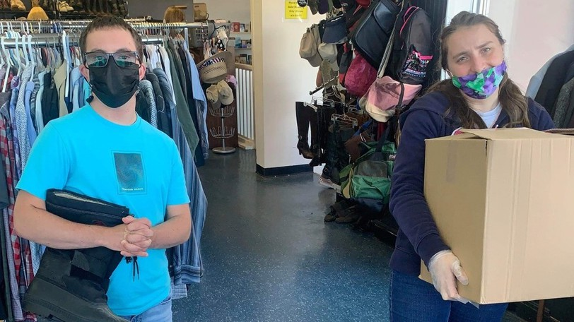 Allen Stanley and Marilena Pocate, members of Community Living Centre, which provides community inclusion for adults with disabilities, work at St. George's Repeat Boutique, which offers low or no-cost clothes and household items to the community.