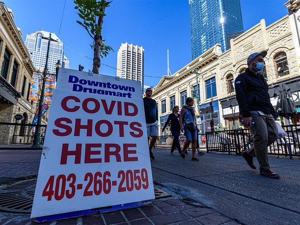A pharmacy sign for COVID-19 vaccine availability is seen on Stephen Avenue in downtown Calgary on Tuesday, Sept. 21, 2021.