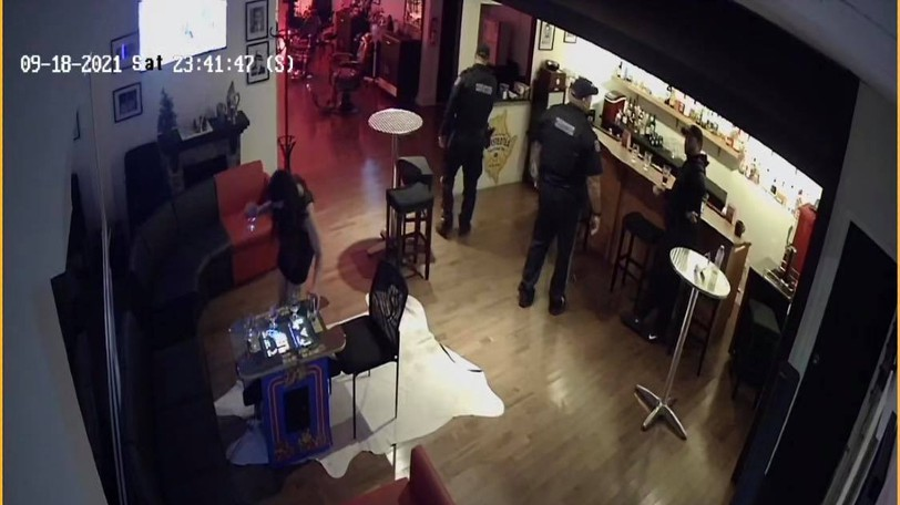 This still from security camera footage at the Royal Barbershop in downtown Fredericton shows an encounter between proprietor Rob Reese, at the right, and provincial enforcement officer Ian Rose.