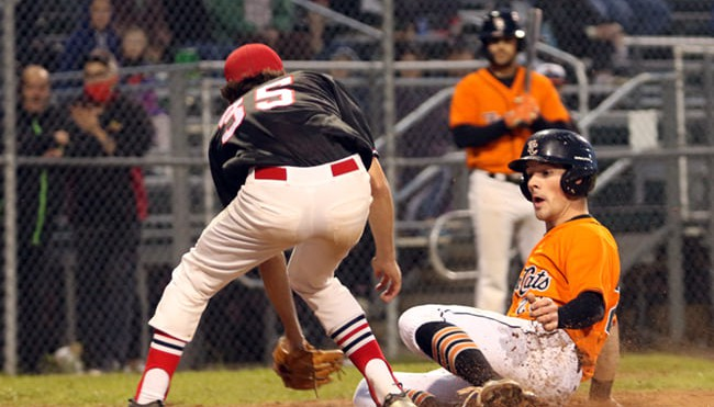 Sam Lund, right, and the Moncton Fisher Cats reached the New Brunswick Senior Baseball League final this month after sitting out the 2020 season due to the COVID-19 pandemic.