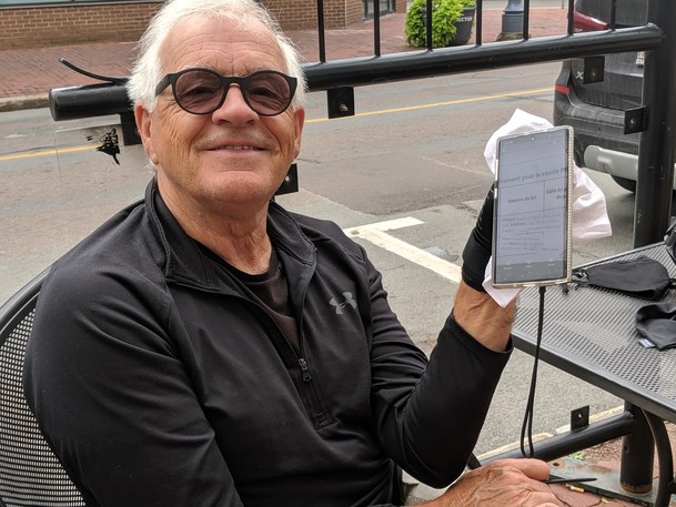 """Pierre Gallant, a Moncton resident, needed to show his proof of vaccination when ordering a drink at Café C'est La Vie on Wednesday. Gallant said providing his vaccination information was easy and gave him a """"level of security."""""""