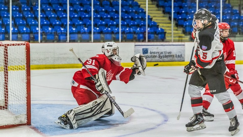 Fredericton Office Interiors Caps goaltender Will Hodgson, shown making a save against the Moncton Flyers, is one of eight returning players for the major U18 hockey team.