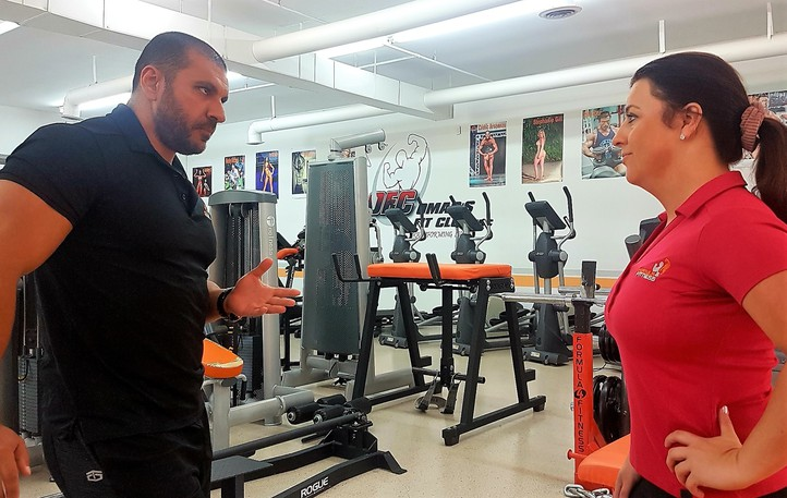 Formula4 Fitness president and founder Omar Ali, who operates a gym at Pepper Creek, talks over the province's new rules that requires people to show proof of full COVID-19 vaccination when accessing certain events, services and businesses with company co-founder Jaclyn Mehan.