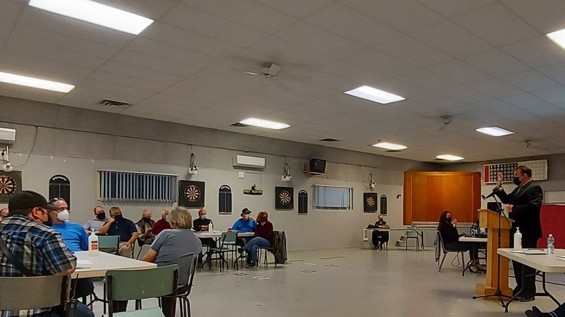 Local Government Minister Daniel Allain addressed a crowd of about 30 people at a roundtable discussion on local governance reform in Pennfield on Wednesday night.