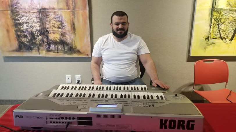 Mohammad Aldoudi is pictured playing his keyboard in Moncton.