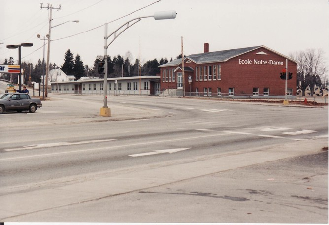 Pictured in this Yvon Doucet photo from the Bathurst Heritage Museum isÉcole Notre-Dame in the 90s, which was locatedon the corner of VanierBoulevardand St. Peter Avenue in Bathurst. A gas station and Kentucky Fried Chicken are now located on this property.