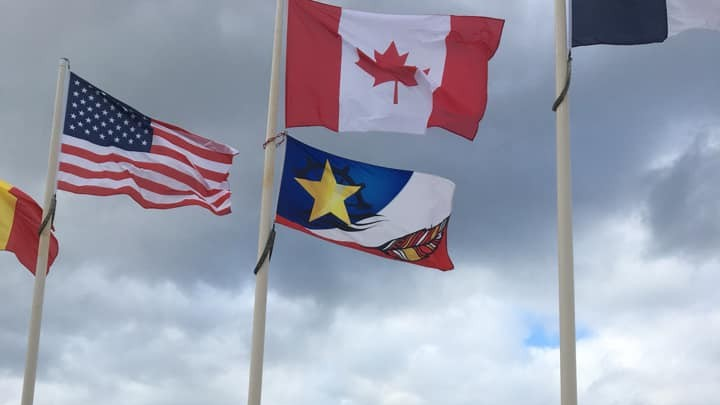 Aubin-sur-Mer, France is flying the flag of Nigadoo to honour Acadian and Mi'gmaq D-Day combatants.
