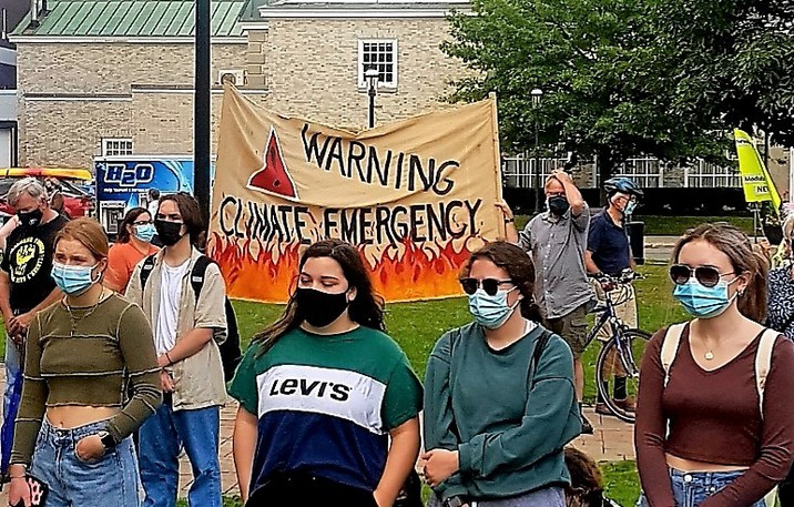 """About 100 people gathered in front of the New Brunswick Legislature in downtown Fredericton over the noon hour on Friday to call on all levels of government to take immediate and effective action on what they believed was a """"climate emergency."""""""