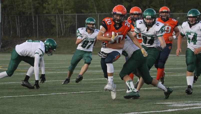 L'Odyssée Olympiens' Brady LeBlanc (No. 20) is tackled by Noah Laffety of the Bernice MacNaughton Highlanders during a New Brunswick High School Football League game on Friday at Rocky Stone Memorial Field.