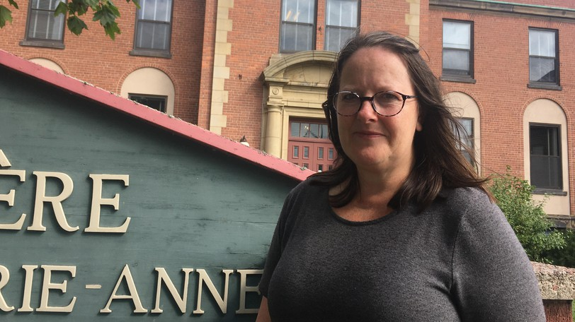 Joanne Duguay, cultural development officer for the City of Moncton, stands outside the former city hospital on King Street, on Saturday, Sept. 25, 2001. This week, the city presented a commemorative plaque to the owners of the designated heritage building.