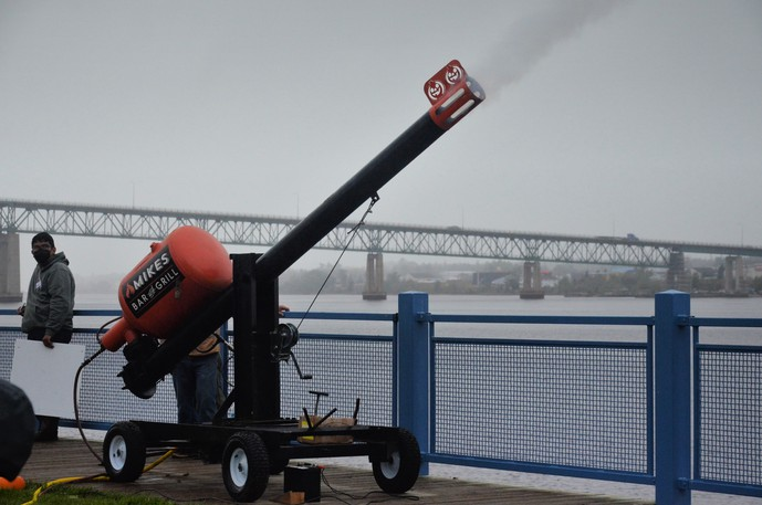 Smoke flies from the barrel of the cannon after a pumpkin was shot from Waterford Green Park toward a floating target in the Miramichi River Saturday at the 20th annual Association of Professional Engineers and Geoscientists of New Brunswick Fall Harvest Pumpkin Fling.