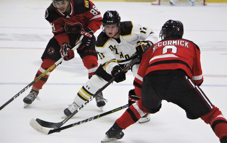UNB Reds rookies Adam McCormick and Isaac Nurse converge on Dal Tigers' forward Derek Gentile in AUS men's hockey conference exhibition action Saturday night at the Aitken Centre. The Reds followed up Friday's 4-0 win over Acadia with a 7-0 victory over Dal.