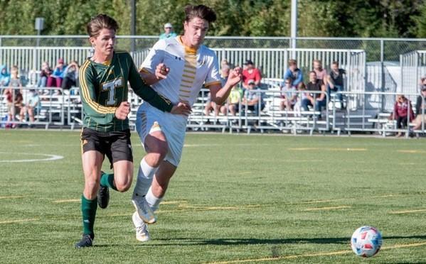 Brett Springer, left, has six goals in four games for the STU Tommies men's soccer team.