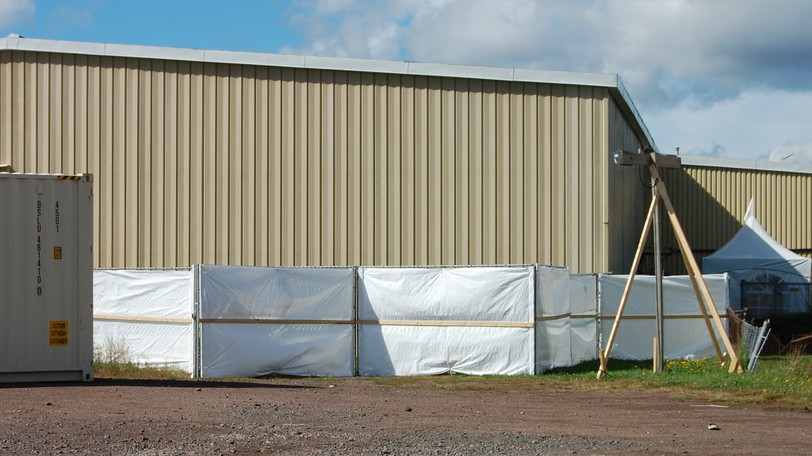 Screened-off fencing surrounds a rear courtyard at the Moncton Lions Club facility on Mark Avenue, the site of an alternate shelter established for self-isolation following a COVID-19 outbreak at Harvest House Atlantic.